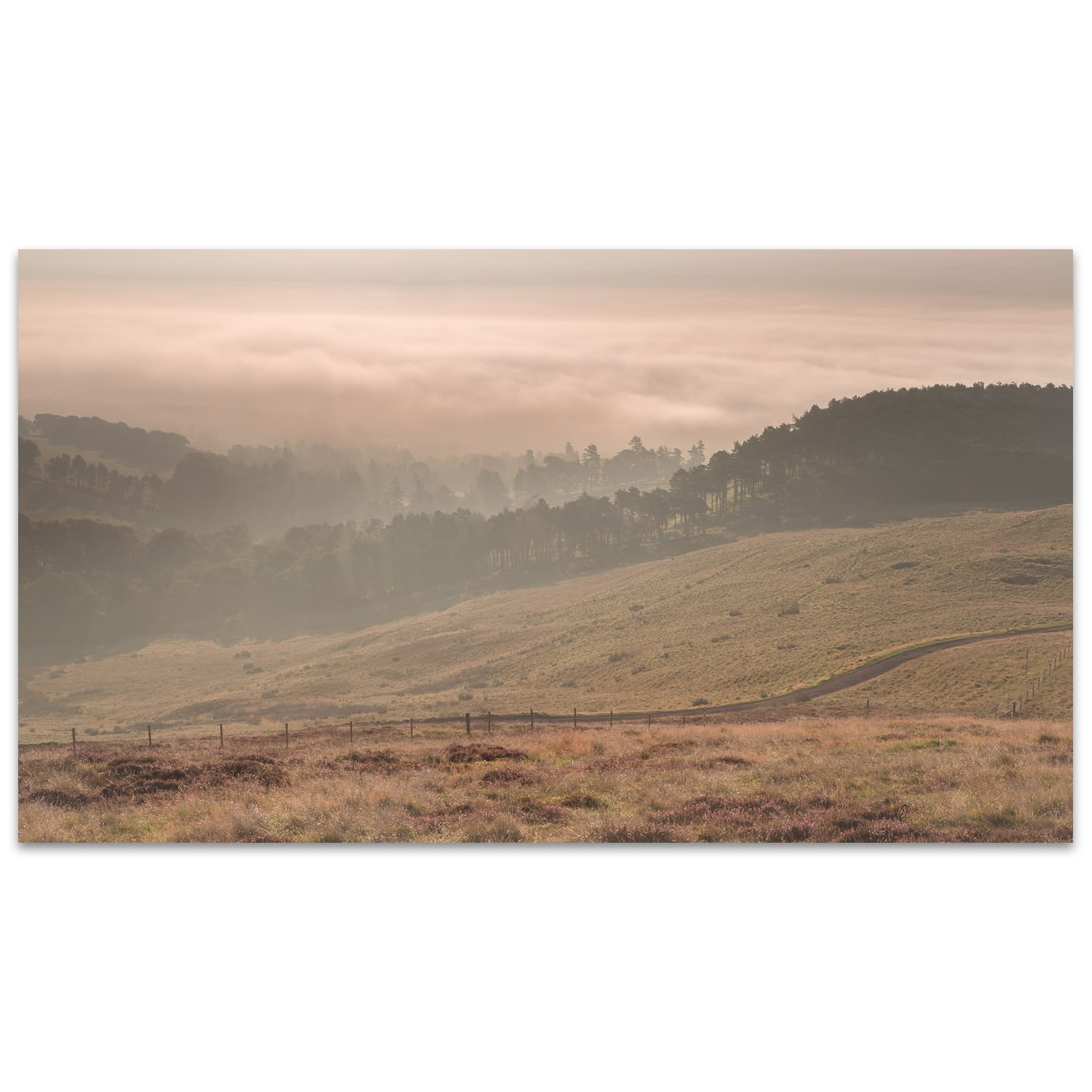 Misty sunrise on the Pentland hills near Edinburgh in Scotland